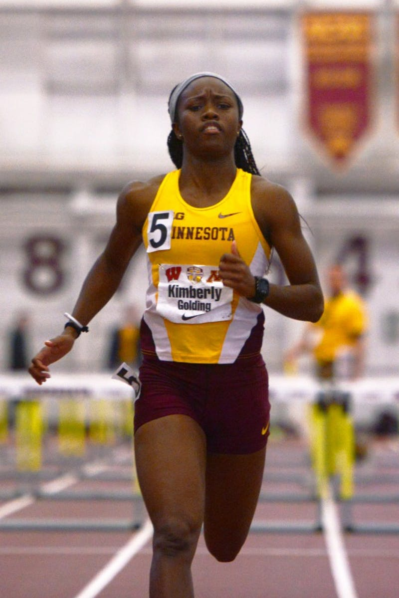 Kimberly Golding continues running after winning the Women's hurdle event at the Field House on Jan. 23, 2016.
