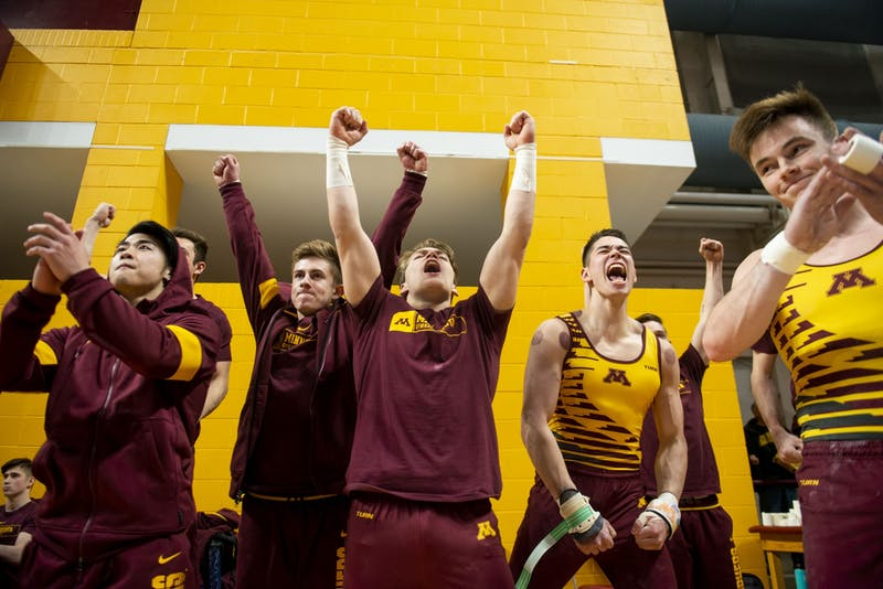 The Gophers cheer for a teammate during their meet against against the Fighting Illini at the Maturi Pavilion on Friday, Jan. 24.