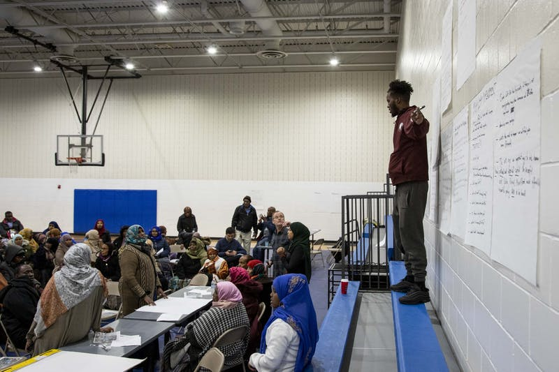 Mohamed Salad, a student at Augsburg University who sits on the board of the Neighborhood Revitalization Program, hosts a listening session regarding the city's Africa Village public marketplace on Thursday, Nov. 21.