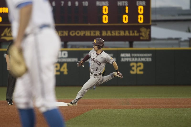 Outfielder Ben Mezzenga rounds second base during the game against UCLA on Saturday, June 2, 2018 at Siebert Field. The Gophers won 3-2.