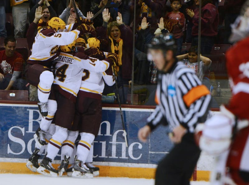 The Gopher mens hockey team celebrates forward Seth Ambroz's game winning goal with seconds left in the game against Wisconsin, Saturday evening at Mariucci Arena.