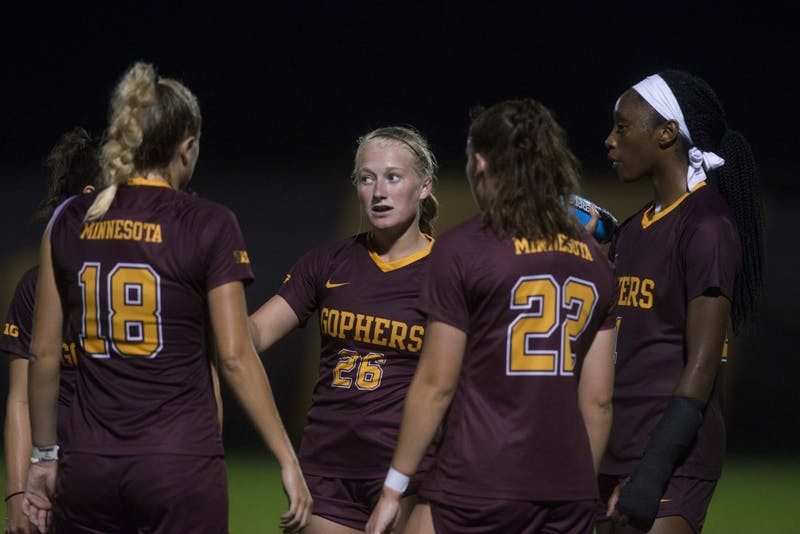 Forward Haley Hartkemeyer huddles with her team at Elizabeth Lyle Robbie Stadium on Thursday, Sept. 12. The Gophers defeated North Carolina State 1-0.
