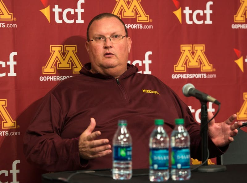Interim head coach Tracy Claeys speaks at a press conference regarding Jerry Kill's resignation on Oct. 25. Kill's departure came as a shock to Claeys and the team.