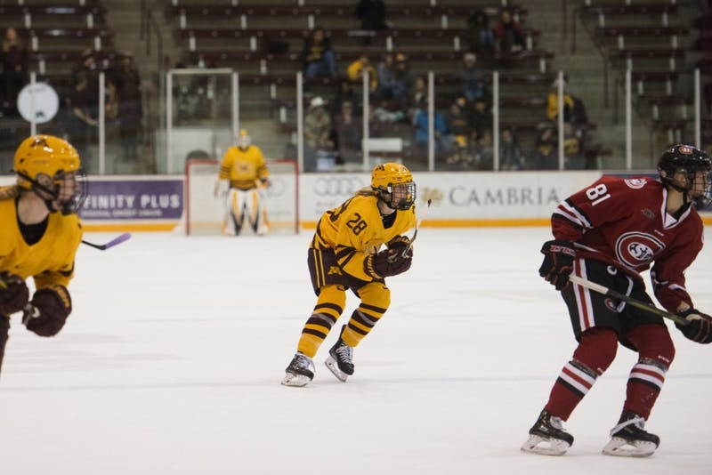 Sophomore forward Taylor Wente eyes the puck during the game against St. Cloud on Sunday, Nov. 18 at Ridder Arena.
