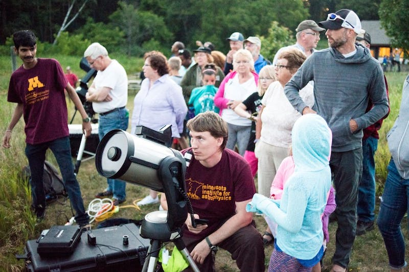 University of Minnesota grad student Karl Young adjusts one the of telescopes at Universe in the Park at William O'Brien State Park on July 2. Universe in the Park is a summer outreach program hosted by the Minnesota Institute for Astrophysics at local and state parks to teach interested attendees about planets and the universe.