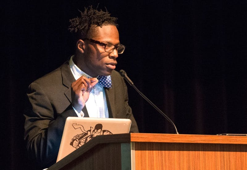 Javaris Bradford, president of the Black Student Union, speaks at their annual Unity Dinner in Coffman Union on Sunday. The group is planning a call to action to bring attention to the importance of the ethnic studies department.