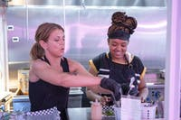 Amanda K., left and Nei'yana Roby prepare sandwiches on Sunday, July 7 at All Square in Minneapolis.