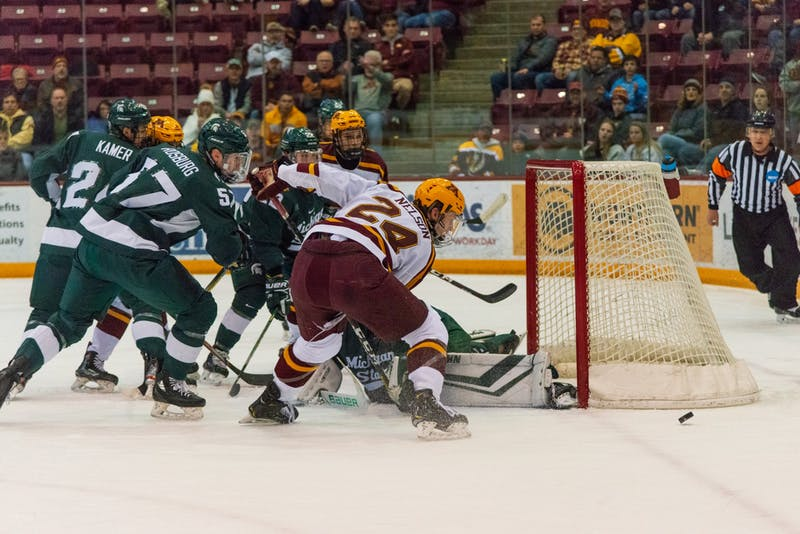 Gophers Forward Jaxon Nelson follows the puck after a goal attempt at the 3M Arena at Marriucci on Friday, Feb. 7. Gophers won against Michigan State 4-1.