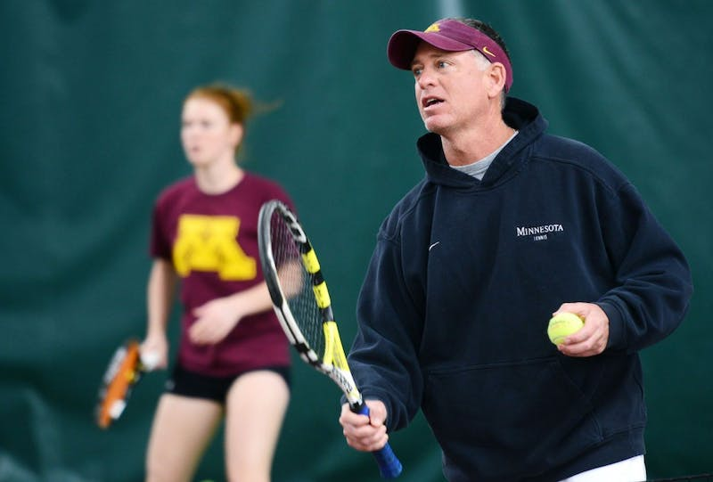 Women's Tennis coach Chuck Merzbacher directs training routines during practice Wednesday, April 3, 2013, at the Baseline Tennis Center.