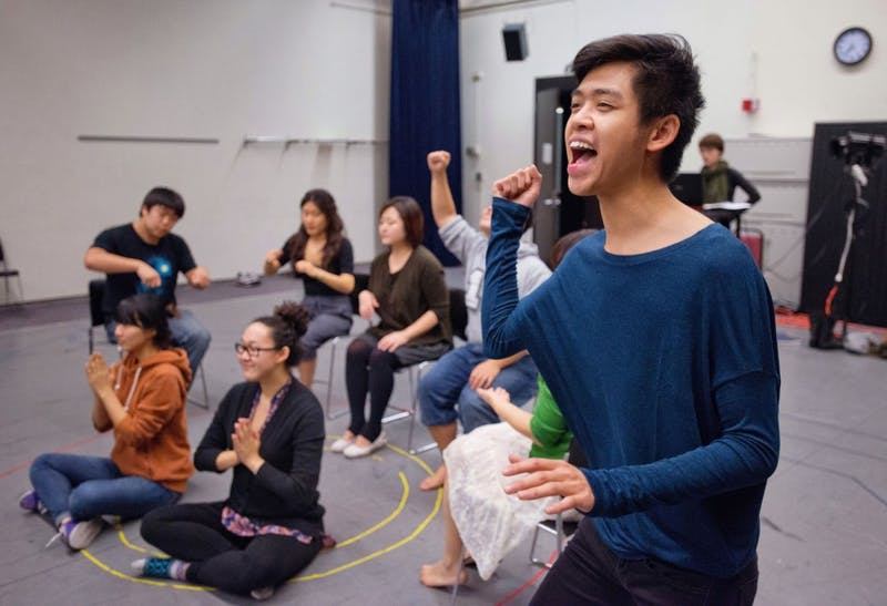 "Theater arts senior Michael Phommasak rehearses a Christmas scene for ""Under My Skin"" at Rarig Center."