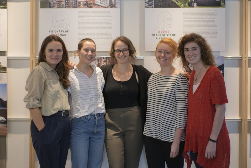 "Mary Begley, Dana Saari, Erin Kindell, Brit Lindsay, and Neva Hubbert members of Women in Architecture Student Organization, or WiASO, pose for a photo in front of their exhibit, ""Gendering Architecture, Architecting Gender,"" on Thursday, Sept. 13 in Rapson Hall."