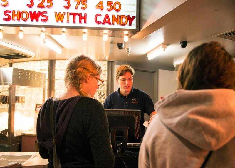 University alumnus Brady Knudson sells movie tickets at the St. Anthony Main Theatre on April 5, 2016. The theatre is one of the venues hosting the 37th annual Minneapolis-St. Paul International Film Festival from April 12-28.