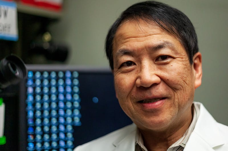 Researcher Atsushi Asakura poses for a portrait in the McGuire Translational Research Facility on Thursday, Jan. 16.  Asakura was one of the lead researchers of a recent University of Minnesota study which demonstrated methods for reducing the symptoms of Duchenne Muscular Dystrophy in mice. (Kamaan Richards / Minnesota Daily)