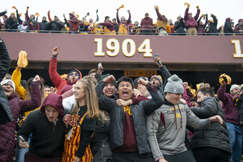 Fans cheer for the Gophers after winning the game against Penn State at TCF Bank Stadium Saturday, Nov. 9. The Gophers won 31-26 bringing their record to 9-0. A first since 1904.