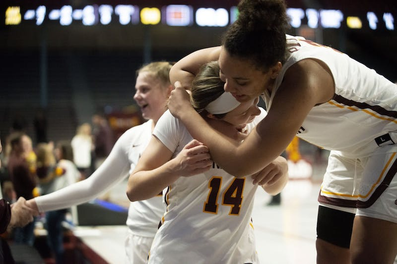Forward Destiny Pitts hugs Guard Sara Scalia after winning against Vermont at William Arena on Sunday, Nov. 10.