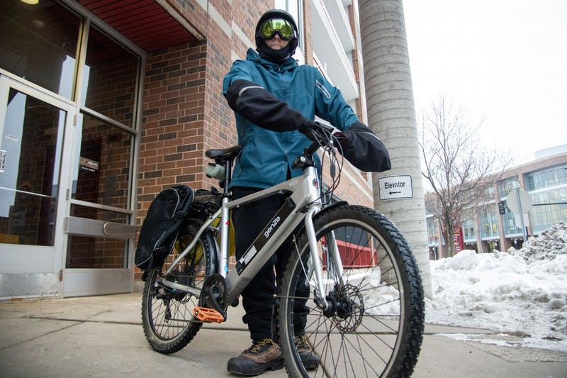 Alternative Transportation Manager Steve Sanders gets ready for his 9-mile commute home on Monday, Jan. 27. Sanders rides his bike to the university everyday, regardless of the weather.