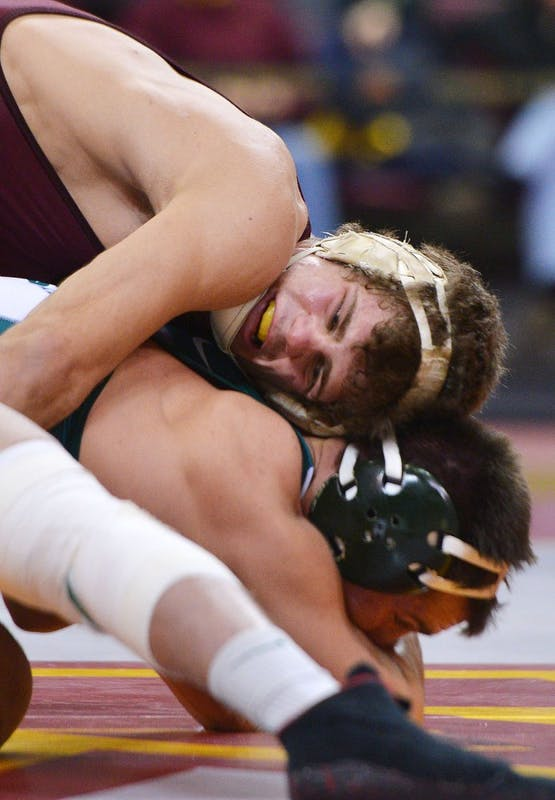 Minnesota's Dylan Ness tries to take down Michigan State's Dan Osterman on Feb. 3, 2013, at the Sports Pavilion.