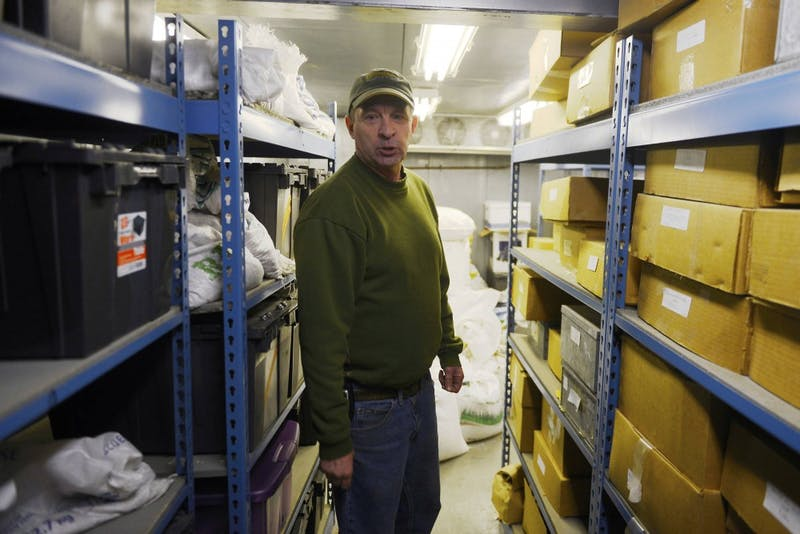 Facility manager Roger Meissner stands inside of a refrigerated seed storage unit in the Plant Growth Facility on the St. Paul campus on Wednesday morning. Seed libraries would be structurally similar to a refrigeration unit like this one.