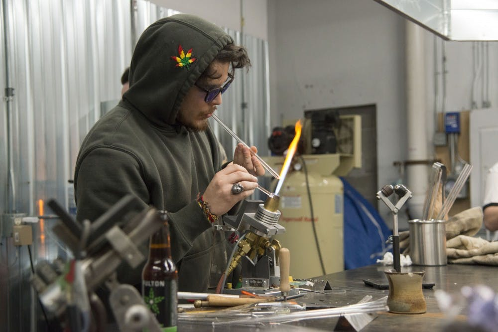 Local artist fires up unique glass artwork