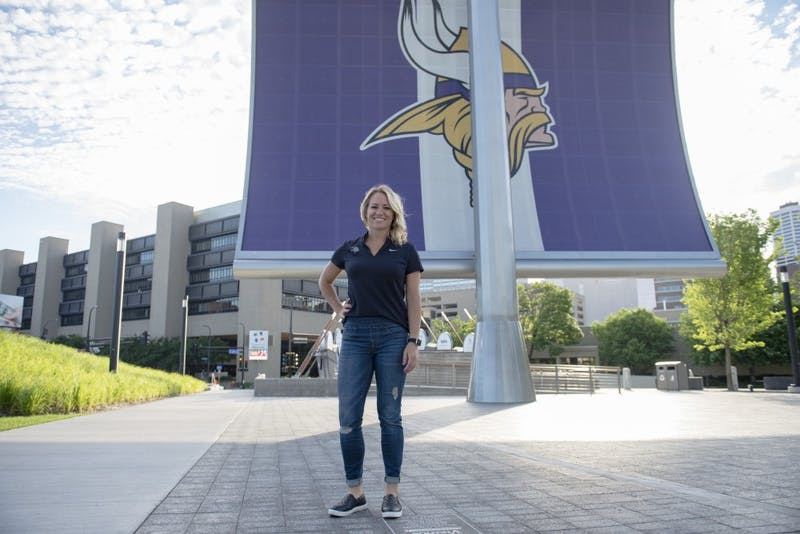 University of Minnesota alumna Kelly Kleine poses for a portrait in front of the US Bank Stadium on Wednesday. Kelly was hired as the college scouting coordinator for the Minnesota Vikings.