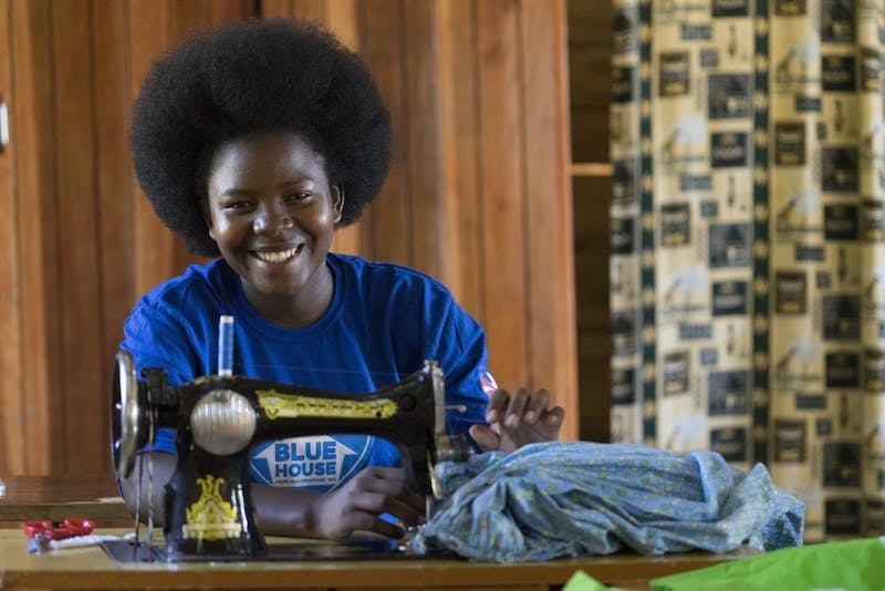 Blue House, a girls' orphanage in rural Uganda, partnered with an apparel design course at the University to create clothing items for the girls in need.