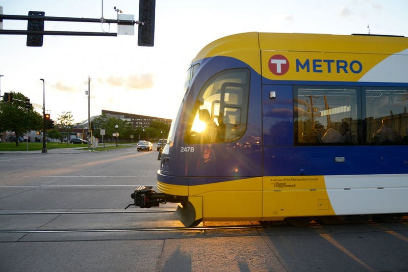 A light rail Green Line train crosses University Avenue in Minneapolis on Monday night. According to Metro Transit, there has been about $3 billion in development along the Green Line corridor since construction began in 2010.