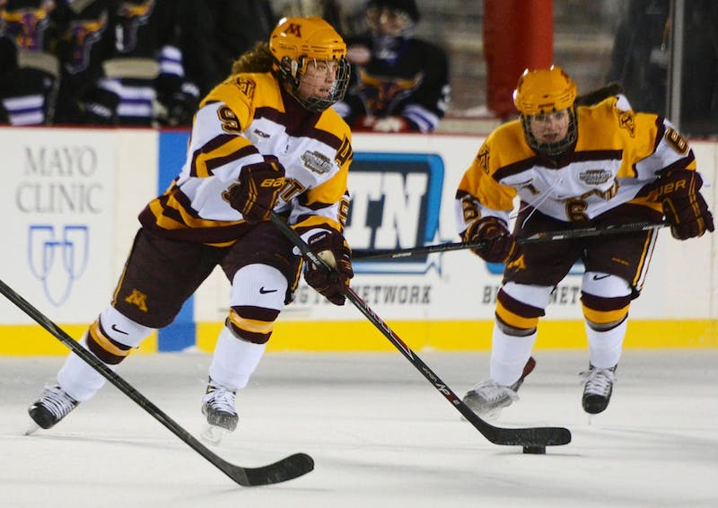 Minnesota forward Sarah Davis passes the puck on Friday at TCF Bank Stadium.