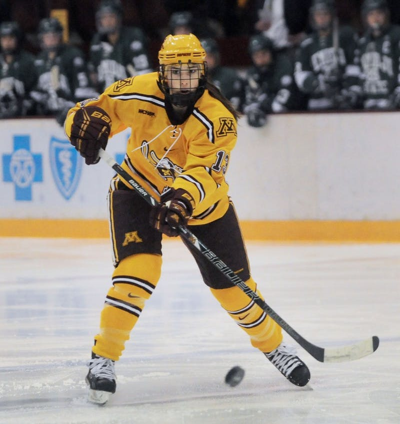 Minnesota defender Milica McMillen handles the puck against Bemidji State, Saturday at Ridder Arena. Gophers won 5-3.