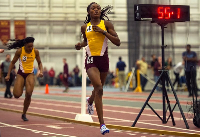 Junior Titania Markland crosses the finish line, placing first in the 400-meter dash during the Jack Johnson Classic at the Field House on January 30.