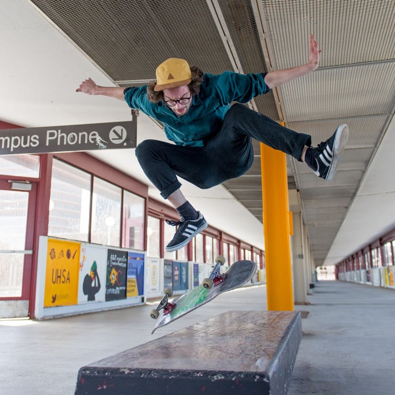 Jonathan MacDonald perfects his skate tricks on the Washington Avenue bridge.