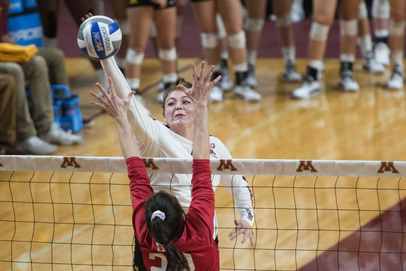 Redshirt Sophomore Regan Pittman jumps to spike the ball at Maturi Pavilion on Friday, Nov. 9. The Gophers swept Indiana in all three sets.