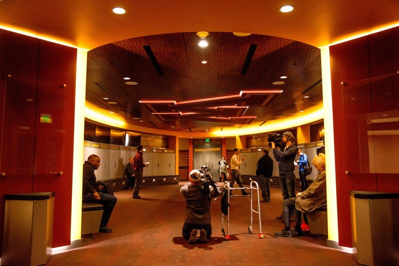 Visitors explore the Mike & Judy Wright football team locker room in the Football Performance Center on Saturday, Feb 10.