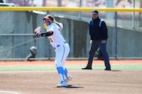 Katelyn Kemmetmueller looks to throw the ball to first base at Jane Sage Cowles Stadium on Sunday, April 14. The Gophers beat Michigan State two games to none as part of their double header.