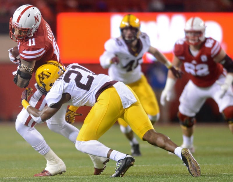 Gophers defensive back Ray Buford tackles Cornhuskers tight end Cethan Carter at Memorial Stadium in Lincoln, Nebraska on Saturday, Nov. 12, 2016.