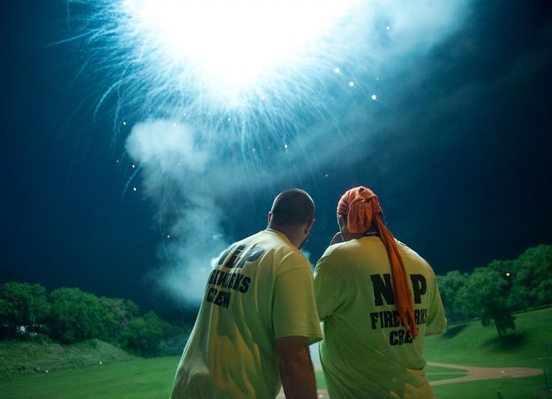 Northern Lighter pyrotechnicians Joe Schroeder, left, and Paul Marchio, right, use a remote device to detonate fireworks at Fred Lawshe Park in St. Paul on June 28.