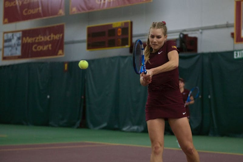 Junior Tina Kreinis returns the ball at the Baseline Tennis Center on Friday, April 12.