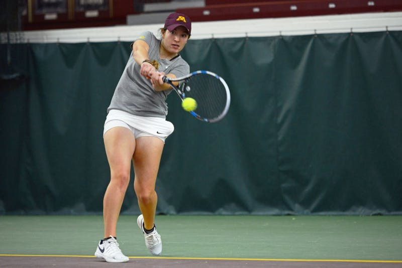 Junior Caitlyn Merzbacher returns the ball during her singles match against the University of South Dakota at the Baseline Tennis Center on Friday, Feb. 9.