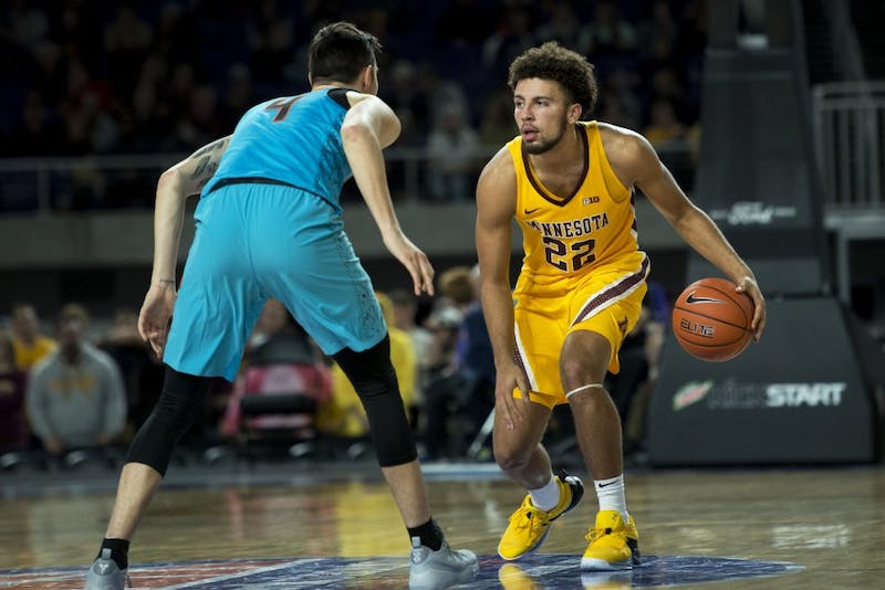 Freshman Gabe Kalscheur looks the defender in the eye as he dribbles the ball at U.S. Bank Stadium in Minneapolis on Friday, Nov. 30. The Gophers beat the Oklahoma State Cowboys 83-76.