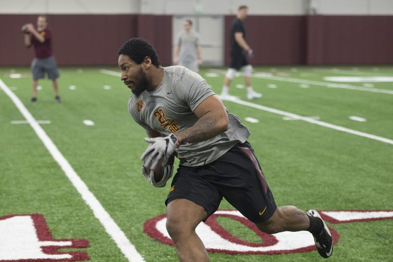 Kobe McCrary runs the ball in an NFL Pro Day drill at the Athlete's Village indoor practice facility on Wednesday, March 28.