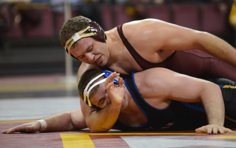 Heavyweight senior Michael Kroells takes on South Dakota State University's Alex Macki in the wrestling team's home opener at the Sports Pavilion on Nov. 19, 2016, where the Gophers beat SDSU.
