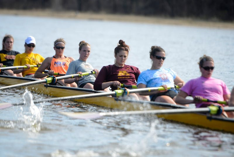 Minnesota's rowing team practices on the Mississippi River on April 22, 2014.