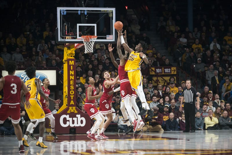 Center Daniel Oturu jumps for a rebound at Williams Arena on Wednesday, Feb. 19. The Gophers fell to Indiana 68-56.