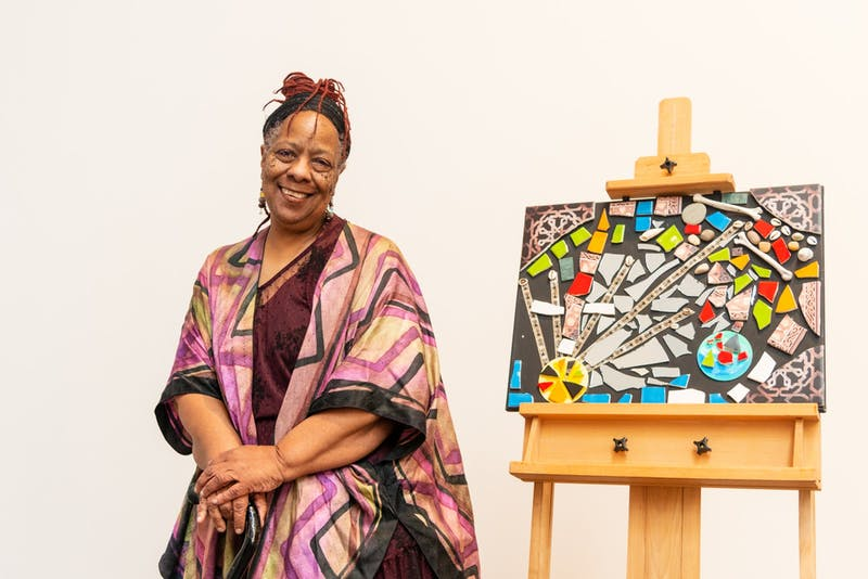 Exhibit Curator Amoke Kubat poses for a portrait in the Weisman Art Museum on Saturday, Feb. 15. Yo Mama's House, an artist, activist and healer cooperative, is celebrating Black History Month and Women's History Month with this pop-up display. (Emily Urfer / Minnesota Daily)
