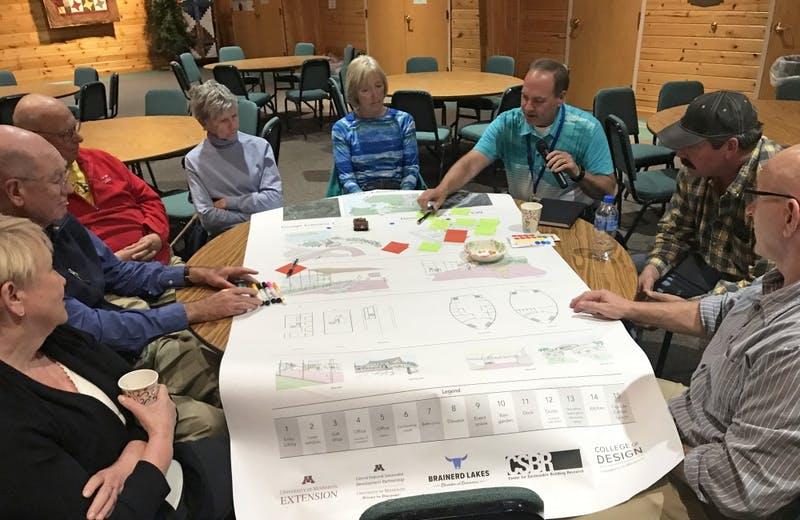 Members of the Crosslake community and the National Loon Foundation look at plans of the proposed National Loon Center at a community meeting led by the University's Center for Sustainable Building Research.