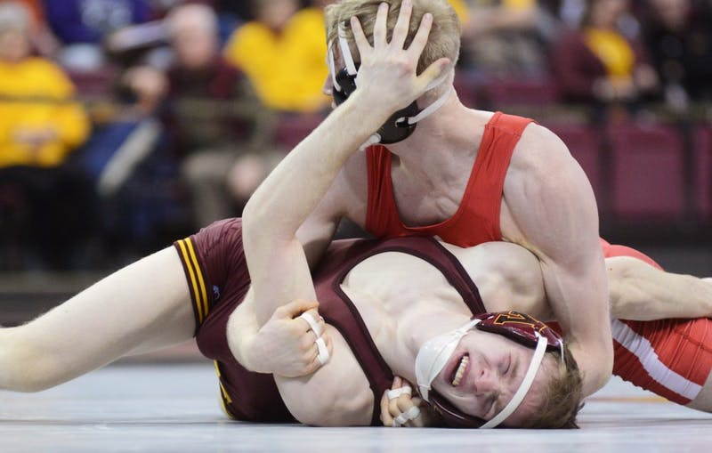 Sophomore Ethan Lizak takes on Nebraska's Tim Lambeth at the Sports Pavilion on Friday, Jan. 20. The Gophers would lose to the University of Nebraska