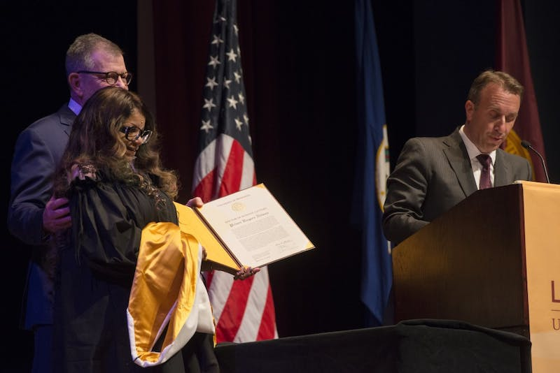 University Regent Darrin Rosha introduces the honorary doctorate as Tyka Nelson, sister of Prince, holds the diploma with President Eric Kaler at the ceremony for the Honorary Doctor of Humane Letters for Prince on Wednesday, Sept. 26. An honorary degree is the highest award conferred by the University of Minnesota, recognizing achievements that have added to the betterment of society.