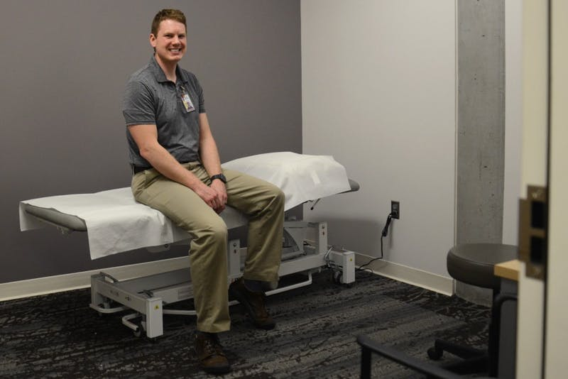 Therapist Joseph Schoess poses for a portrait inside the new physical therapy room at the University Recreation and Wellness Center on Tuesday, April 4, 2017.