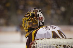 Junior goaltender Mat Robson eyes the puck during the game against the University of Minnesota Duluth on Sunday, Oct. 7 at Mariucci Arena.