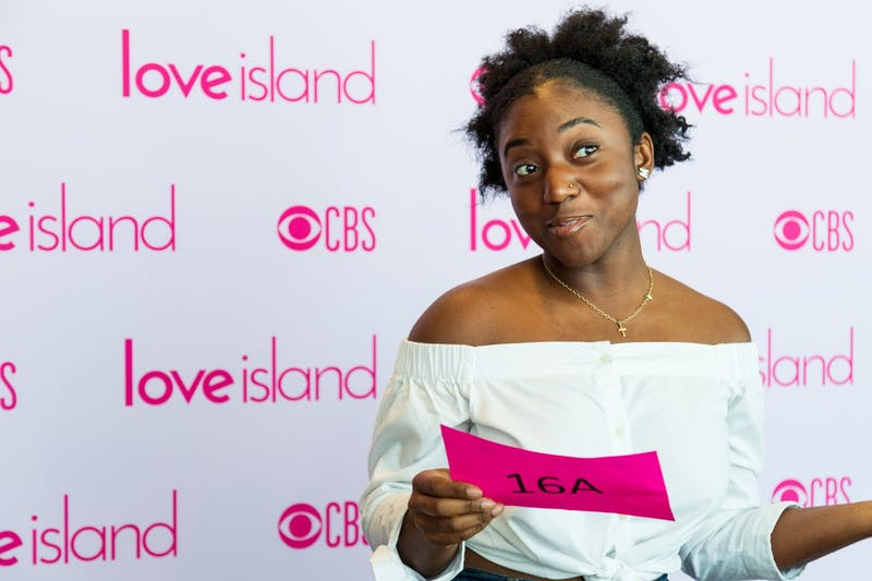 Auditionee Mimi Ewuakye poses with her call number at an open casting for 'Love Island' at Surly Brewing Company on Saturday, Feb. 15.