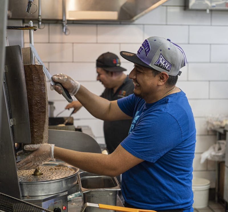 Cook Danny Herrera cuts lamb shawarma on Friday, June 28 at Afro Deli in Stadium Village, Minneapolis.